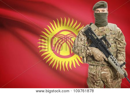 Soldier Holding Machine Gun With Flag On Background Series - Kyrgyzstan