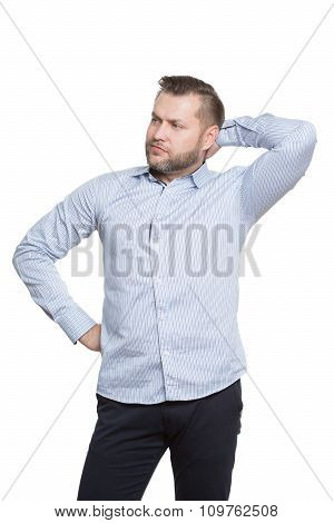 adult male with a beard. isolated white background. fist on her hip, hand behind head. gesture of ar