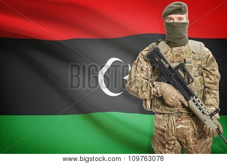 Soldier Holding Machine Gun With Flag On Background Series - Libya
