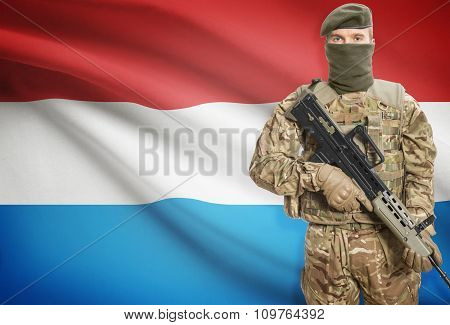 Soldier Holding Machine Gun With Flag On Background Series - Luxembourg
