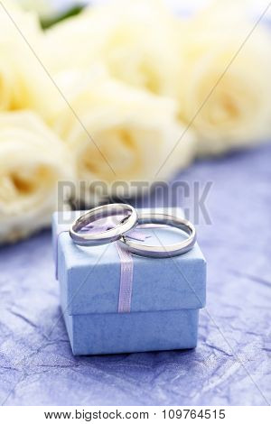 Silver Wedding Rings On A Purple Paper Background