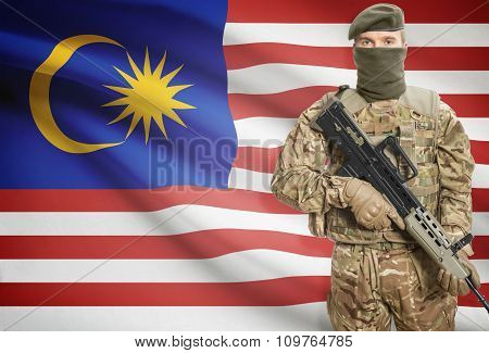 Soldier Holding Machine Gun With Flag On Background Series - Malaysia