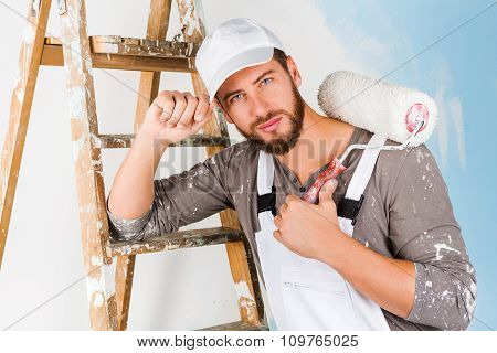 Handsome Painter With Paint Brush