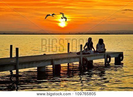 Women talking on the pier