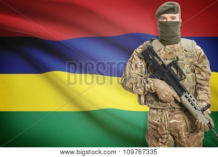 Soldier Holding Machine Gun With Flag On Background Series - Mauritius