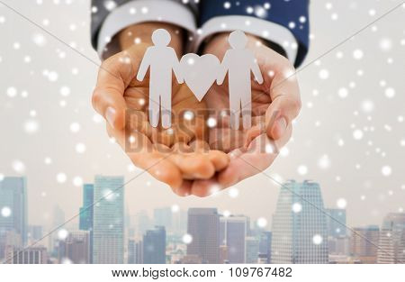 people, homosexuality, same-sex marriage and love concept - close up of male gay couple holding love and gender symbol over snow effect