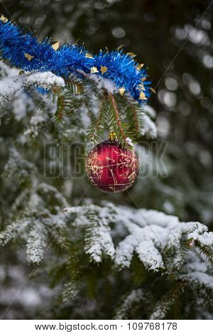 Red Ball And Blue Tinsel On The Christmas Tree