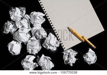 Notepad And Crumpled Paper Balls