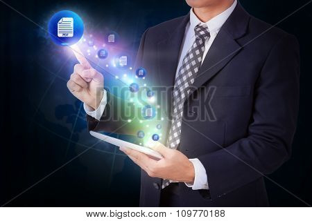 Businessman holding tablet with pressing mail pdf icon button. internet and networking concept