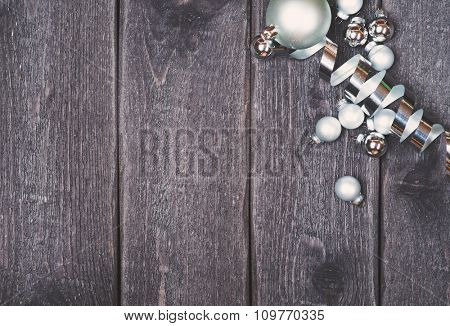 Silver Christmas decoration on wooden vintage background