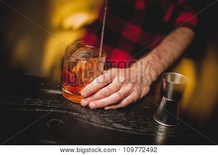 Bartender Is Stirring Cocktails On Bar Counter