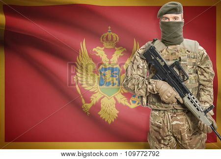Soldier Holding Machine Gun With Flag On Background Series - Montenegro