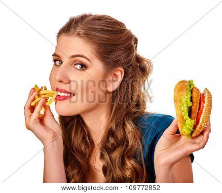 Portrait of young beautiful woman eating   hamburger and fried potatoes.  Isolated.