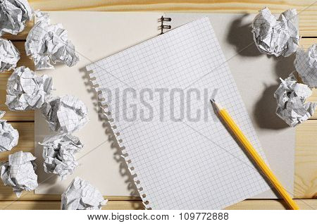 Crumpled Paper And Empty Notepad