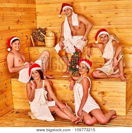 Large roup people in Santa hat  celebration Christmas in sauna.