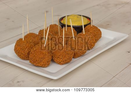 Dutch Snack Bitterballen With Mustard And Cocktail Picks