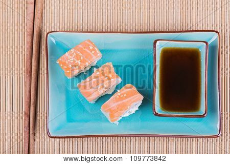 Top view to california maki sushi with salmon