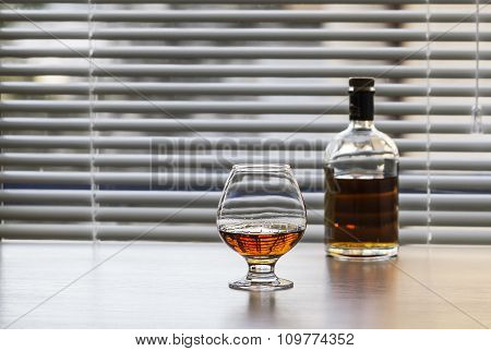 Bottle And A Glass Of Brandy.