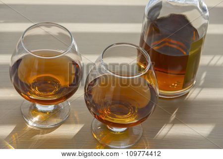 Bottle And Two Glasses Of Brandy.