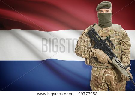 Soldier Holding Machine Gun With Flag On Background Series - Netherlands