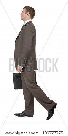 Businessman walking side view
