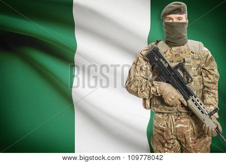Soldier Holding Machine Gun With Flag On Background Series - Nigeria