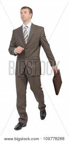 Businessman running with suitcase, side view