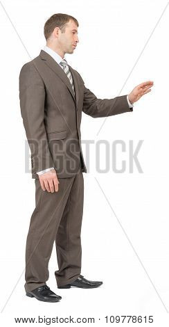 Businessman with outstretched hand, side view