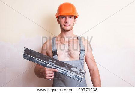 Man In Overalls With A Large Spatula