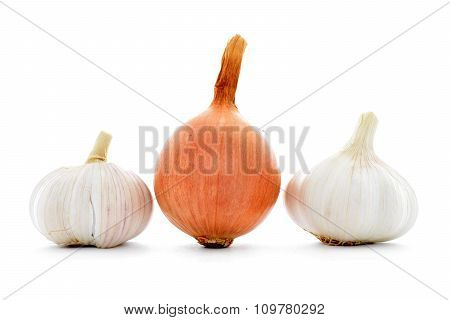 Whole fresh gold onion, two garlic bulbs isolated on white