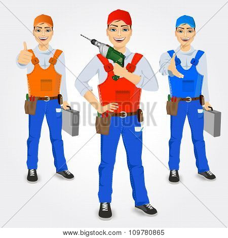 set of handymen holding green drill