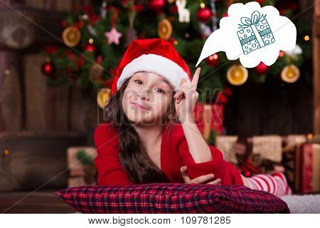Beautiful Santa girl dreaming near the Christmas tree, making a wish. New year atmosphere