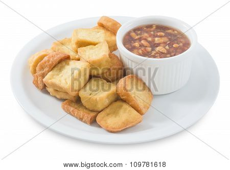 Fried Tofu Bubble With Sweet Sauce On White Background