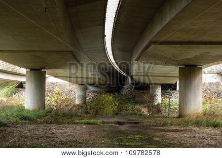 Underneath a large motorway bridge