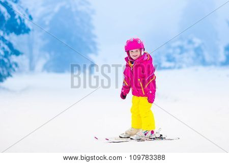 Little Child Skiing In The Mountains In Winter