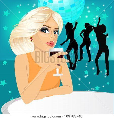 blonde woman drinking wine