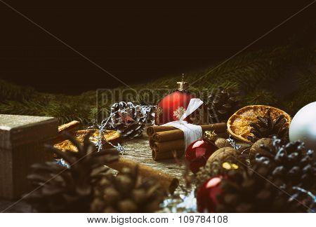 Christmas Decoration. Cinnamon Sticks, Dried Oranges, Baubles, Cones, Walnuts.