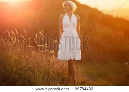 Woman Walking In Sunset