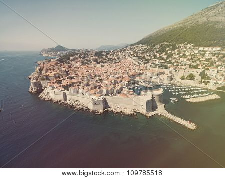 Aerial view of old city of Dubrovnik (Croatia), popular tourist attraction on Adriatic. Post processed with vintage filter.