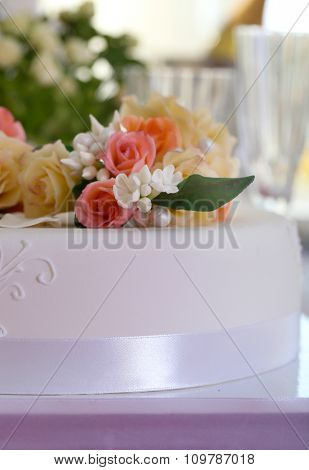 Beautiful cake with decorations for wedding or other celebration in restaurant, close-up