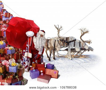 Santa Claus and his reindeer with gifts
