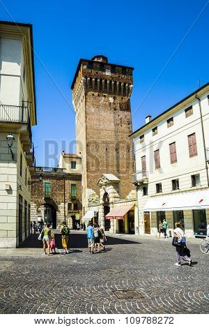 People Walk Along The Place In Front Of Tower  Torre Di Castello