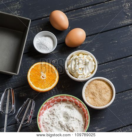 Ingredients For Baking. Raw Ingredients - Flour, Eggs, Butter, Sugar, Orange - To Cook Orange Cake.