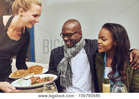African American Couple Being Served Dinner