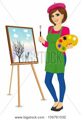 female painter artist holding palette and brush