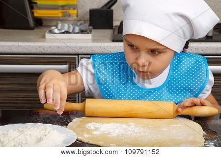 Little Girl Is Playing As A Cook