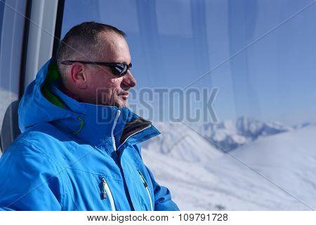 Man In Ski Gondola