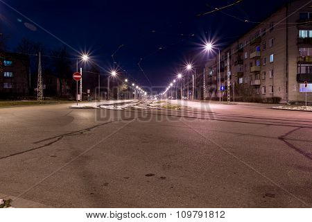 View of the city at night with tram tracks