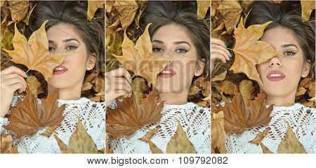 Nice girl covered with autumnal leaves. Young woman laying down on the ground covered by leaves