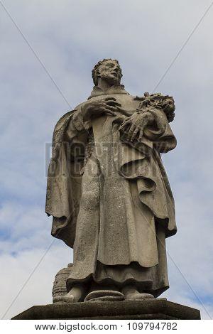 Statue Of Saint Philip Benizi De Damiani On Charles Bridge In Prague